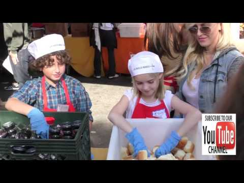 August Maturo and McKenna Grace giving Thanksgiving Dinner to the homeless at LA Mission in Los Ange