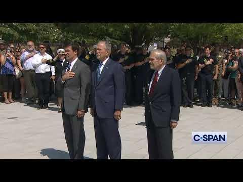 President George W. Bush places a wreath at Pentagon Memorial.