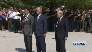 President George W. Bush places a wreath at Pentagon Memorial.