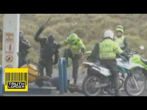 Colombian riot police beat protesters - Truthloader