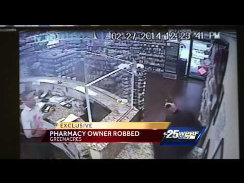 Caught On Video: Armed man in black robs pharmacy