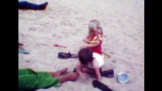 cine film: young children playing on a beach in 1974, no sound
