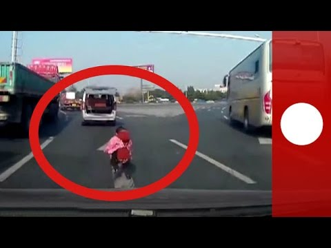 Terrifying moment toddler falls out of moving van on highway