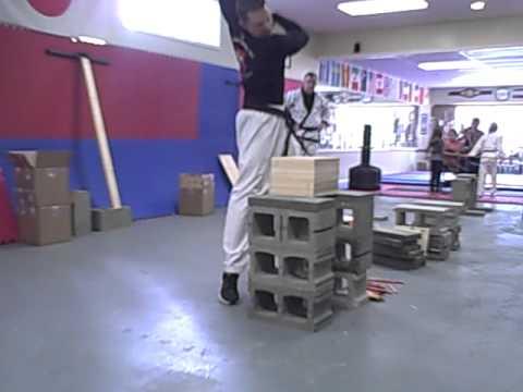 Seth Britton sets an un-spaced wooden board Elbow break on 10 boards