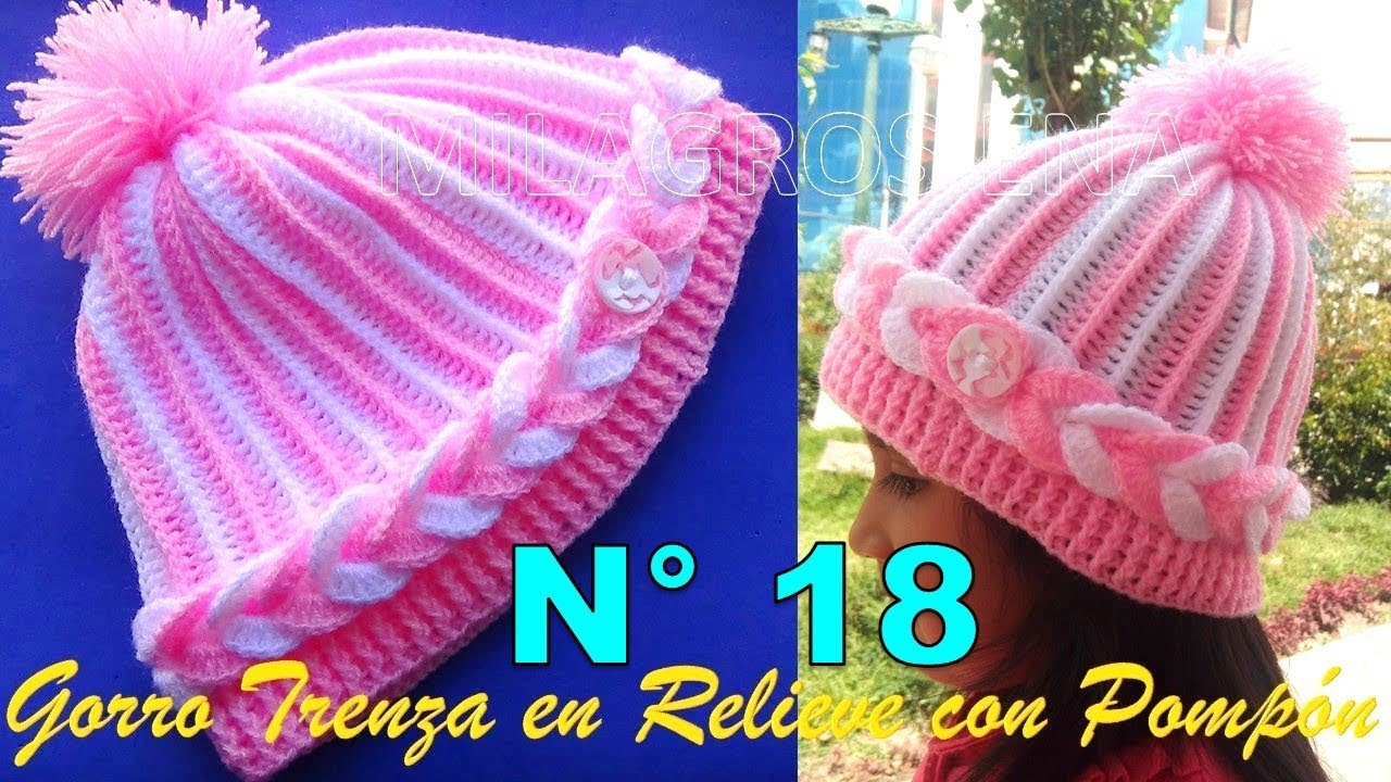 Gorro a crochet para niñas en punto trenza en relieve con pompón ... 0d9260a7f09