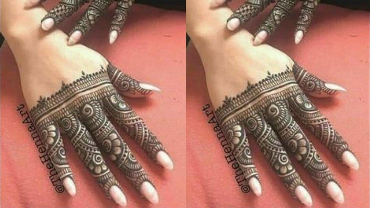 mehendi design back hand fingers