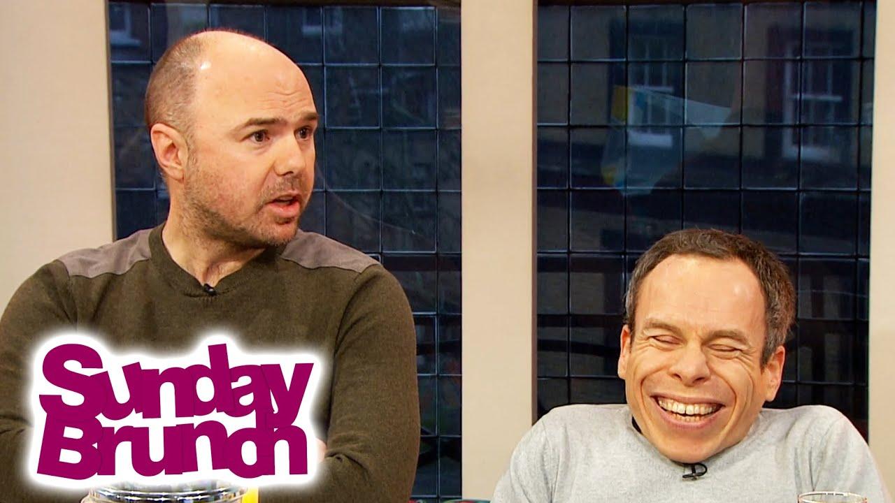 Karl Pilkington & Warwick Davis Joke With Each Other on Sunday Brunch