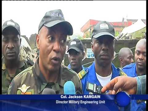MILITARY ENGINEERING UNIT DEMOLISHES UNSTABLE BUILDING IN BONAPRISO,DOUALA, CAMEROON