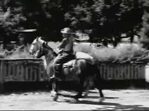 """Al """"Fuzzy"""" St. John Dismounts a Horse"""