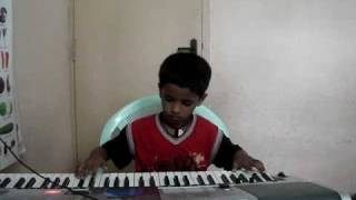 Padmesh playing Kurai Ondrum illai Song on keyboard - This devotional song written by Rajaji