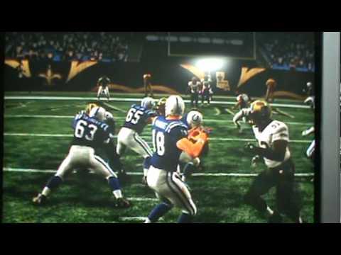 Peyton Manning sacked by  Ellis defensive linemen