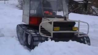 Самодельный гусеничный снегоход,чистка снега.