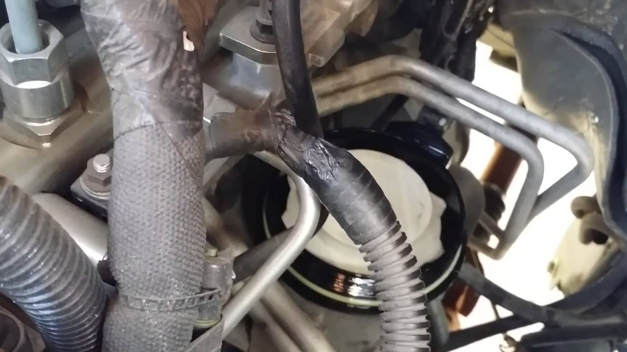 installing diesel fuel filter on 2012 6 7 liter cummins [ 1280 x 720 Pixel ]