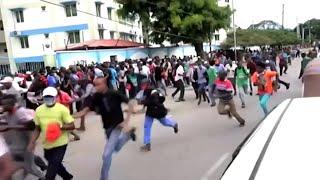 Police disperse crowds with teargas ahead of coronavirus curfew in Kenya