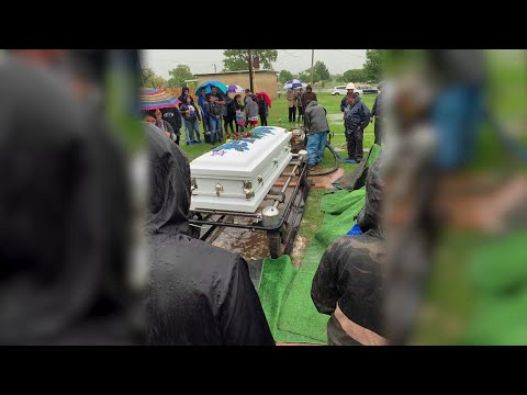 Mourners Forced to Scoop Water Out of Grave During Funeral