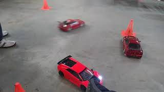 My dad playing RC car at his friends house inside the garage rock crawling and drifting cars