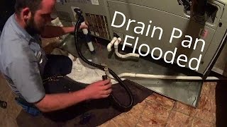 HVAC Service: Secondary Drain Pan Flooded and A Shocking Air Conditioning Unit 8-19-15