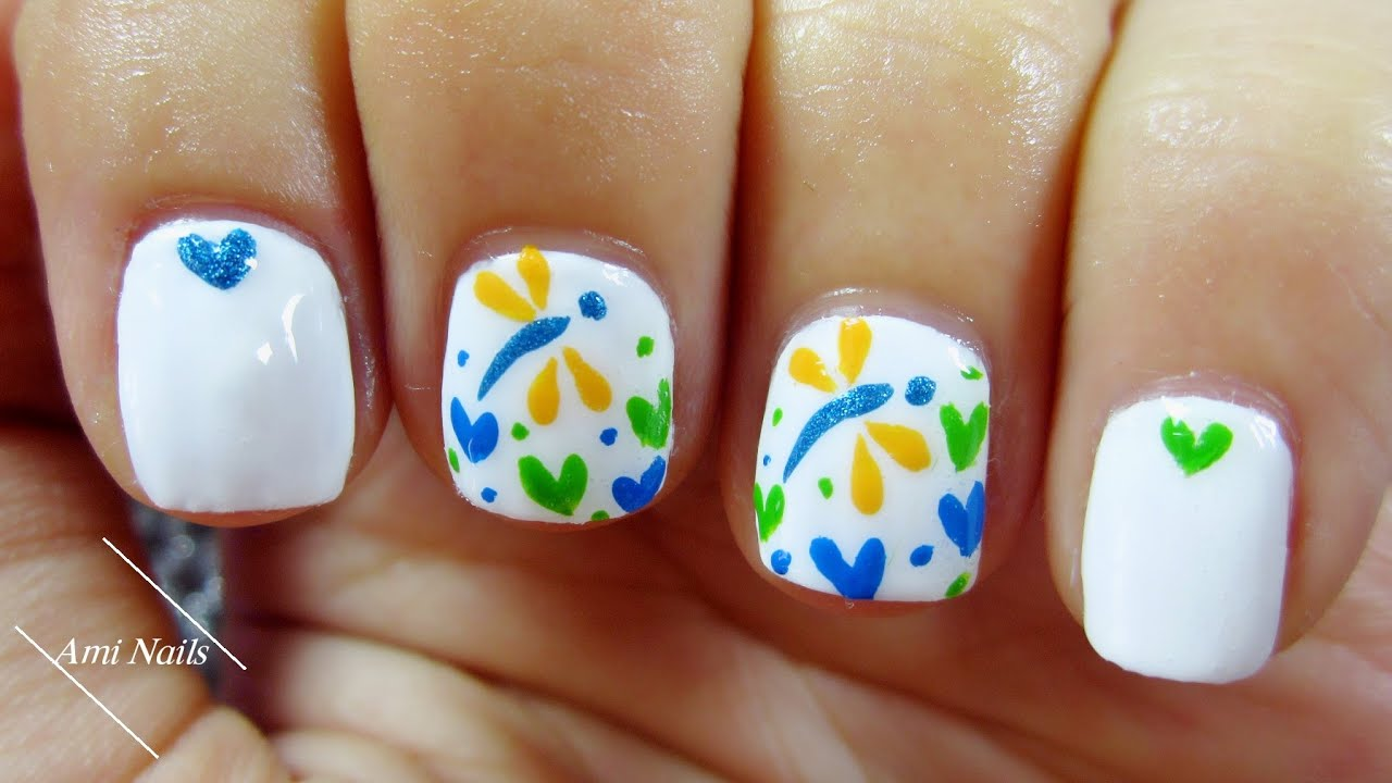 cute dragonfly and heart nail art
