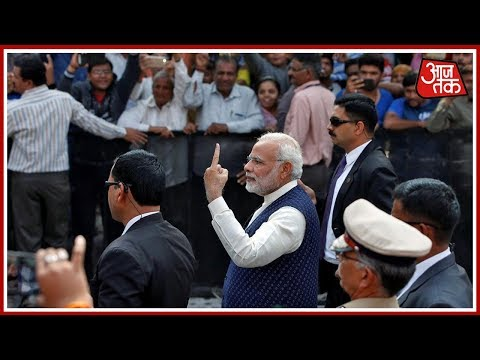 Narendra Modi Casts Vote In Sabarmati, Walks With Inked Finger For Crowd,