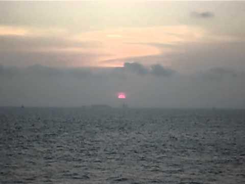Sun setting offshore Angola, Africa.AVI