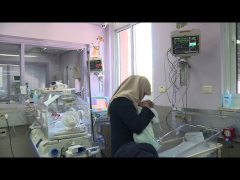 Gaza mother reunited with baby amid Israel entry row