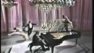 Liberace playing a classic