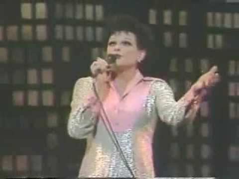 JIM BAILEY as Judy Garland at  'Winter Olympics Ceremony'