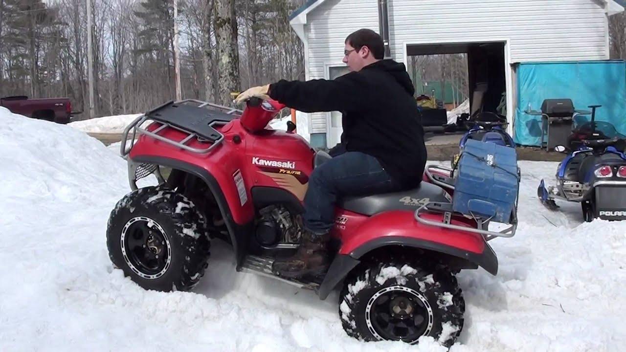 Kawasaki 650 prairie- Stuck In Snow - YouTube