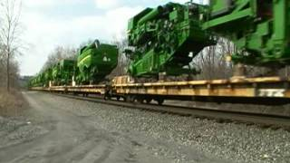 SD60 Leader! Norfolk Southern 63A Farm Equipment John Deere Tractors and some CASE ones.
