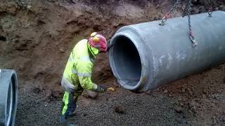 Excavator Laying Concrete Drain Pipes, The Whole Experience!