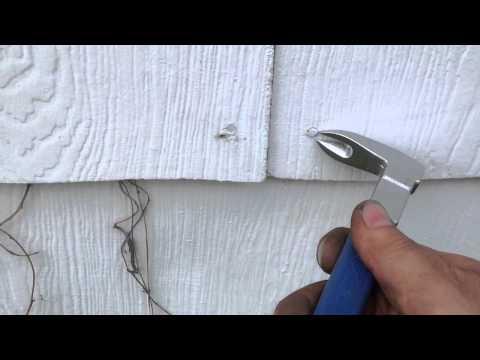 pulling-nails-from-asbestos-siding