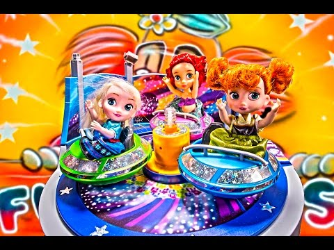Anna and Elsa toddlers at the funfair with Ariel and Chelsey, thrill rides, playing and fun