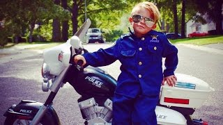 5-Year-Old Boy Wears Police Uniform While Riding Motorcycle To Protect Neighbors