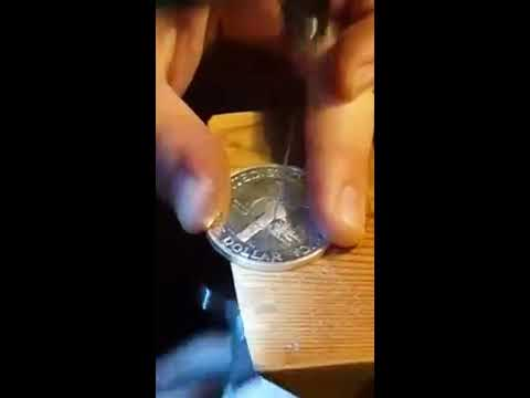 Jewelers proper sawing technique for coin ring center hole