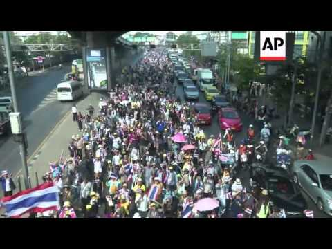 Anti-government protest leader Suthep Thaugsuban leads protesters in march around Bangkok