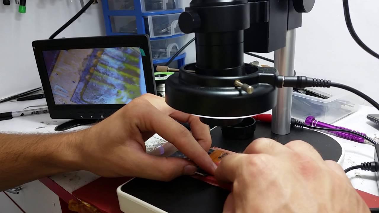 Smartel GSM Refacere trasee la microscop si reparatii telefoane scapate in apa