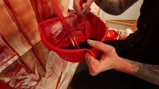 Artist uses real blood to protest Trump