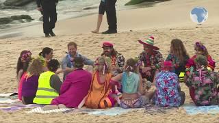 Royals Harry and Meghan go barefoot on Bondi beach, Australia