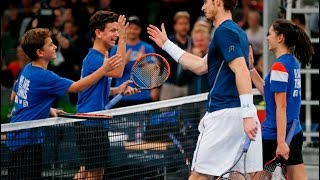 Andy Murray plays a double with 3 ball boys