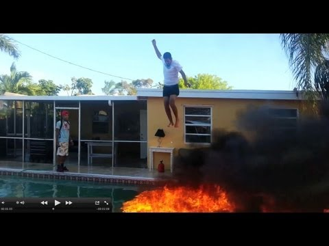 Guy Jumps Off Roof Into Pool Of Fire Youtube