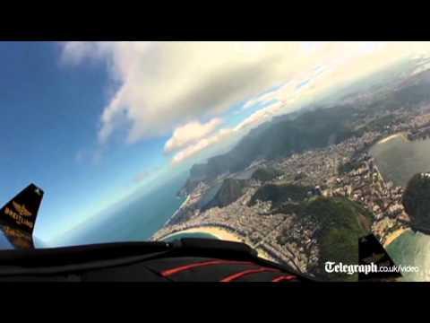 Jetman Yves Rossy soars over Rio de Janeiro skyline