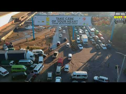 Traffic being controlled by Soilder  in Harare