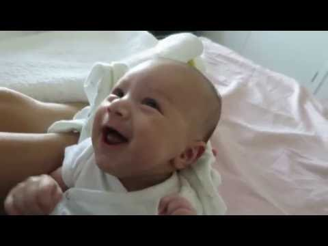 7 week old baby smiling and laughing because of gas or Thai language