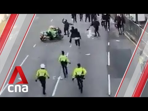 Hong Kong Police Officer Drives Motorcycle Into Crowd Of Protesters