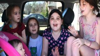 Cute baby sings We Will Rock You.