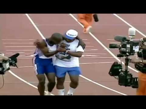Inspirational Olympic momentFather and son finish the race together-