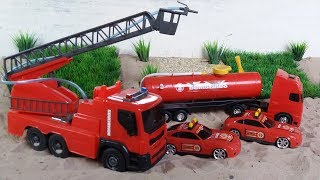 playing with fire truck and rescue truck, doing the rescue of the carts