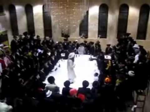 Rebbe of Minkatch at Mishteh Hayain tish Purim 5771.wmv