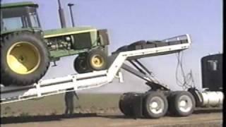 Landoll tilt bed trailer loading the tractor - YouTube