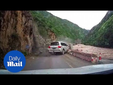 Terrifying rockslide almost crushes car on narrow mountain road - Daily Mail